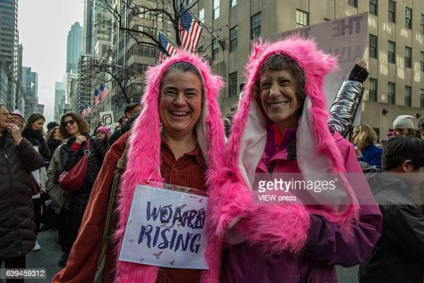 Women wearing pink hats attend to the Women's March in New York City on January 21 2017 Protesters in the United States and around the world are...