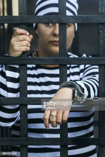 Women wearing prisoner's uniforms take part in a protest against a proposed law that would prohibit abortions due to irreparably damaged fetuses...