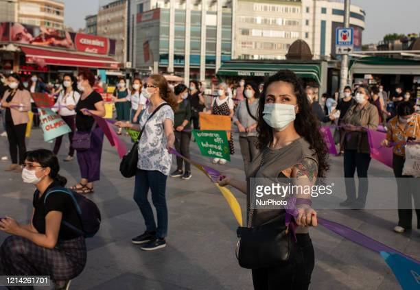Women wearing protective face masks seen during a demonstration in Istanbul Turkey to protest violence against women and child abuse during the...