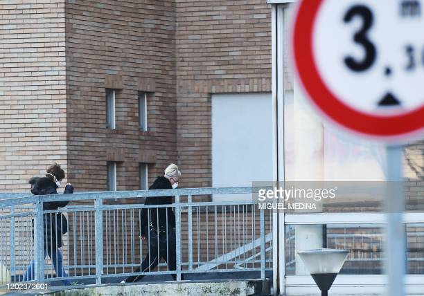 Women wearing protective respiratory mask enter the municipal hospital in Codogno, southeast of Milan, on February 22, 2020. - An Italian man became...