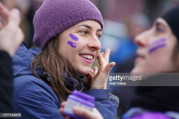 Women wearing purple and riding bicycles prepare to participate in the Purple Ride feminist women's bicycle protest on International Women's Day on...