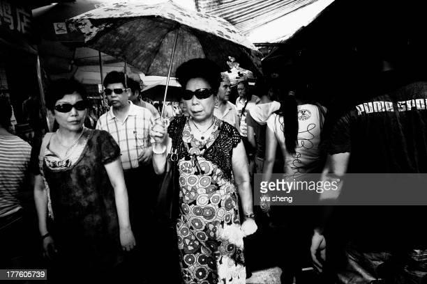 CONTENT] Women wearing sunglasses walking in the street