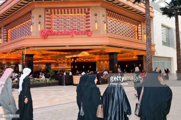Women wearing the black Abaya walk past The Cheesecake Factory in the Mall of the Avenues Opened in November 2012 it has 475 seats The Mall of the...