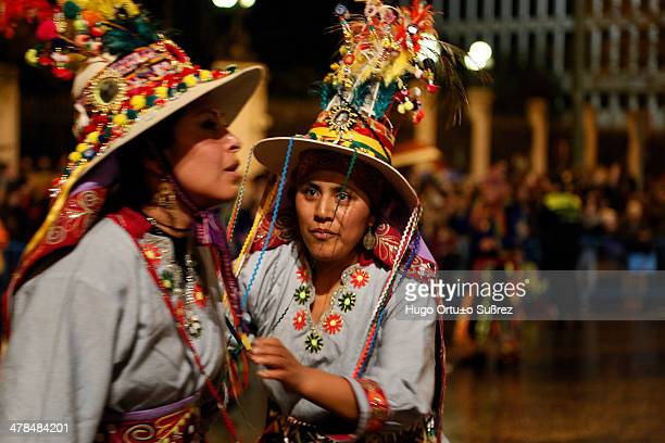Women wearing traditional Bolivian costumes perform a dance during their participation in the beginning of the Madrid Carnival. Thousands of people...