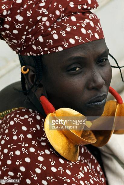 Women wearing traditional clothes with big dangling earrings Mopti Mali