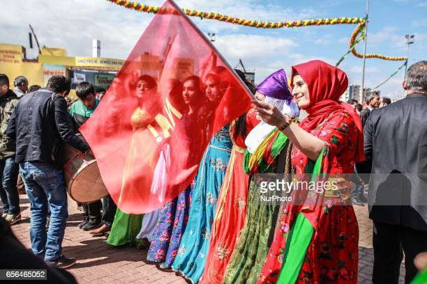 Women wearing traditional dresses dance during a gathering to celebrate Newroz, on March 21, 2017 in Diyarbakir, Turkey. Thousands of Kurds gather...