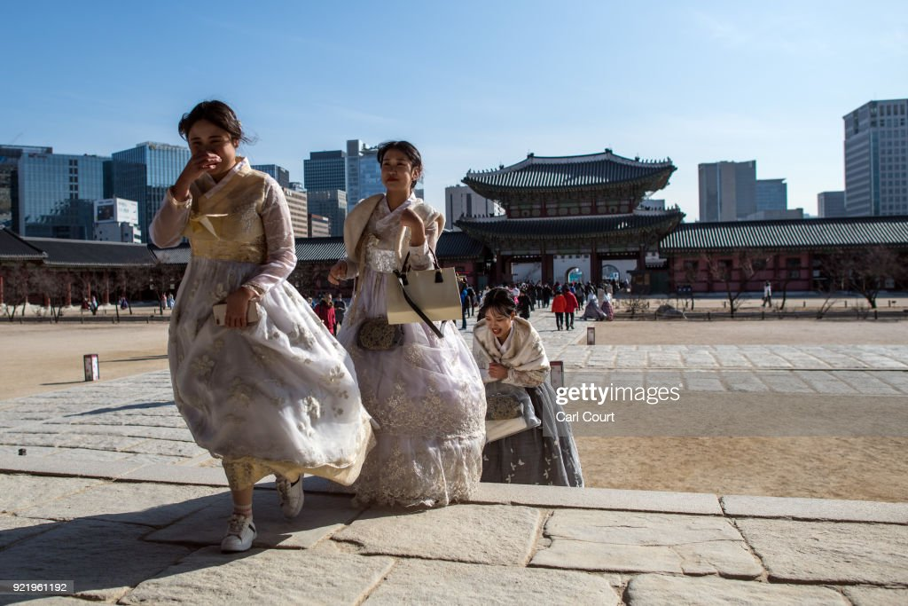 Women wearing traditional Korean Hanbok dresses visit Gyeongbokgung Palace on February 21, 2018 in Seoul, South Korea. With tourists visiting from around the world, leaders from South Korea's capital as well as GyeongGi and Gangwon Provinces have agreed to work together to support the PyeongChang Olympic Games and to invigorate regional tourism.