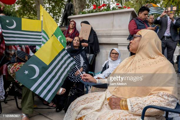 Women wearing traditional sari's waving Kashmiri flags during a pro Kashmir protest at Parliament Square on the 3rd September 2019 in London in the...