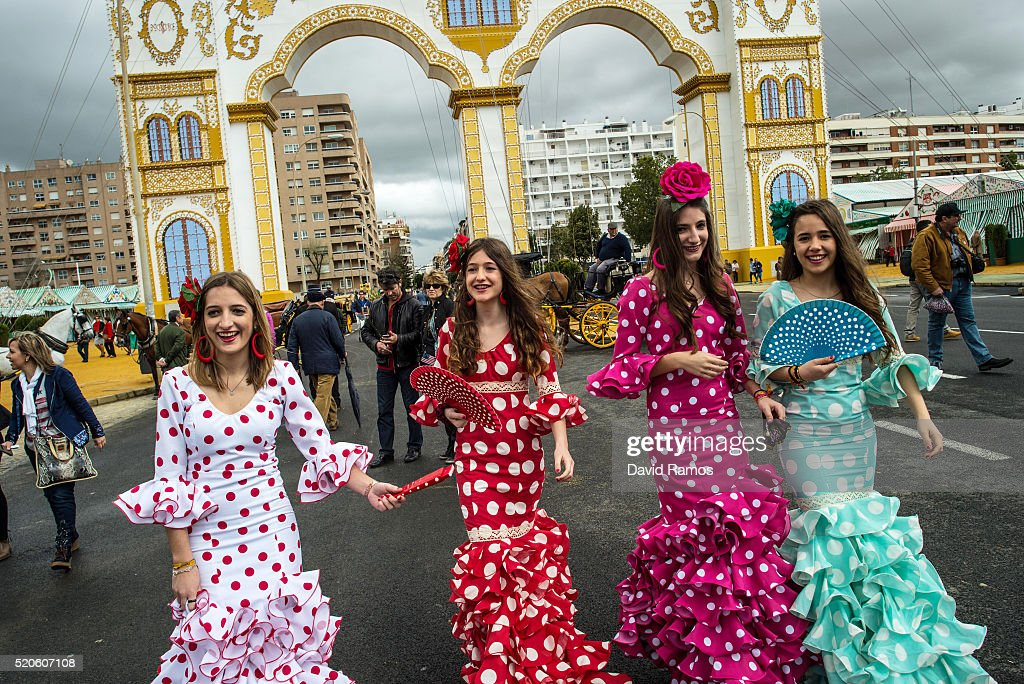 Women wearing traditional Sevillana dresses walk towards the Feria de Abril (April's Fair) on April 12, 2016 in Seville, Spain. The Feria de Abril, which has a history dating back to 1857, takes place a fortnight after Easter each year. The origin of the fair was a cattle market but the event quickly turned its goal from commerce to having fun. More than 1 million local and international participants are expected to attend to Feria de Abril.