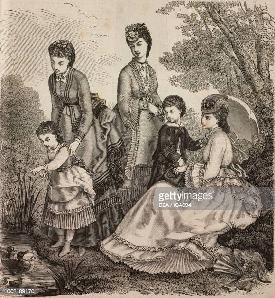 Women wearing walking clothes with flounces folds and fringes and boys and girls' clothes Madame Fladry designs France engraving from La Mode...