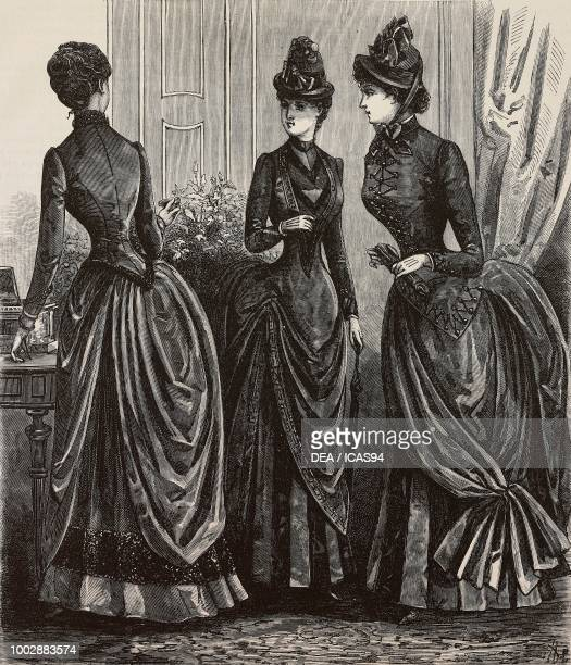 Women wearing winter dresses designs by Madame Coussinet engraving from La Mode Illustree No 45 November 8 1885