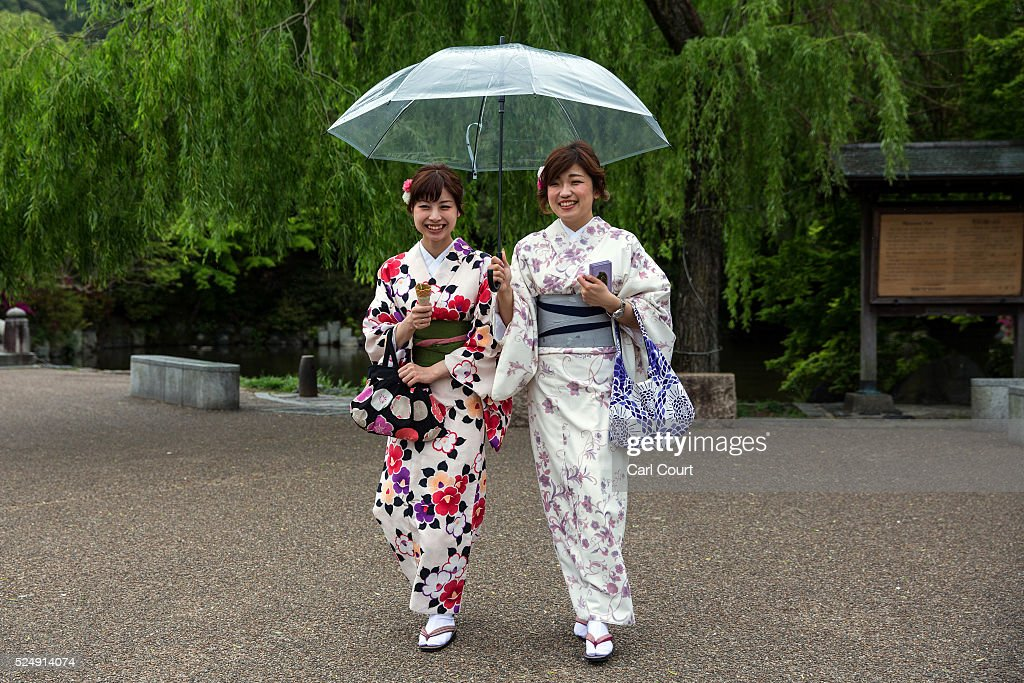 Women wearing yukatas, a light, unlined, summer kimono made of cotton instead of the traditional silk, walk through a park on April 27, 2016 in Kyoto, Japan. Now the seventh largest city in Japan, Kyoto was once the Imperial capital for more than one thousand years, it is now the capital city of Kyoto Prefecture and a major part of the Kyoto-Osaka-Kobe metropolitan area.