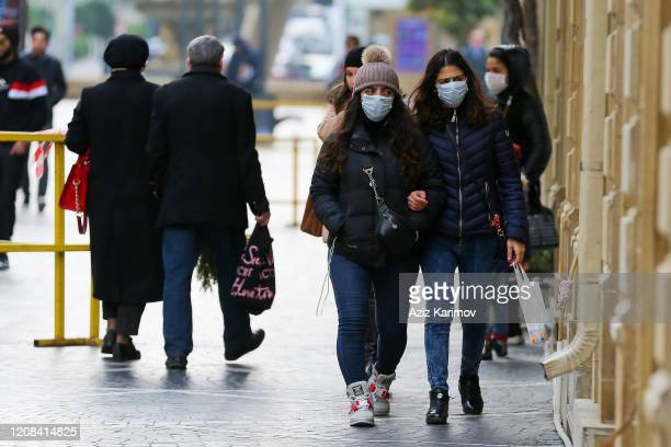 Women wears a mask in center of Baku on February 24 2020 in Baku Azerbaijan Due to the situation in Iran due to the coronavirus Azerbaijan has...