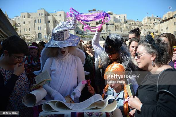 Women wears costumes on the second day of Purim The women of the wall gathered at the Western Wall in Jerusalem to read the Megillah a role...