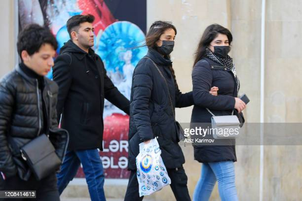 Women wears masks in center of Baku on February 24 2020 in Baku Azerbaijan Due to the situation in Iran due to the coronavirus Azerbaijan has...