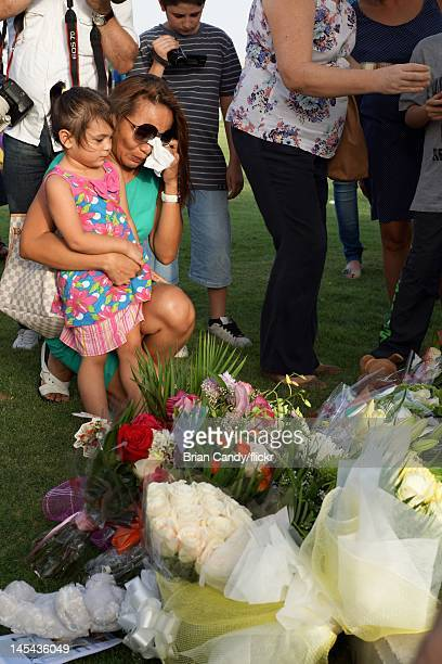 A women weeps as mourners attend a vigil for the 19 victims of the Villaggio mall fire in Aspire Park on May 29 2012 in Doha Qatar 13 of the victims...