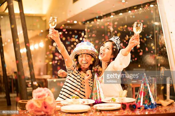 women who are clamoring at the birthday party - japanese girl stock photos and pictures