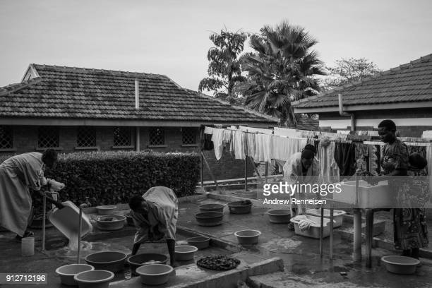 Women who are staying with their children wash clothes inside the Cure hospital compound on February 2 2017