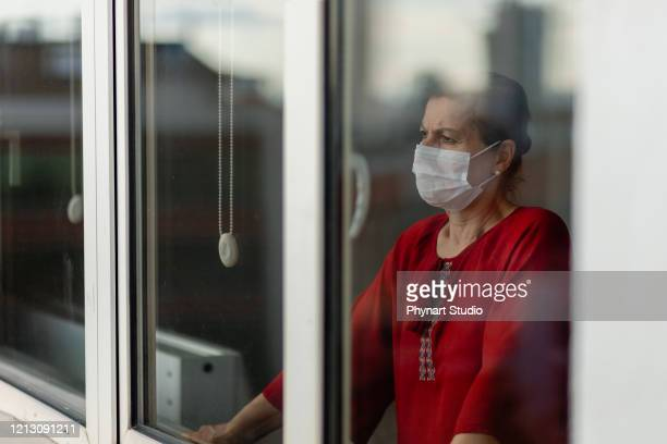 women who cannot leave the house due to an epidemic - pandemic illness stock pictures, royalty-free photos & images
