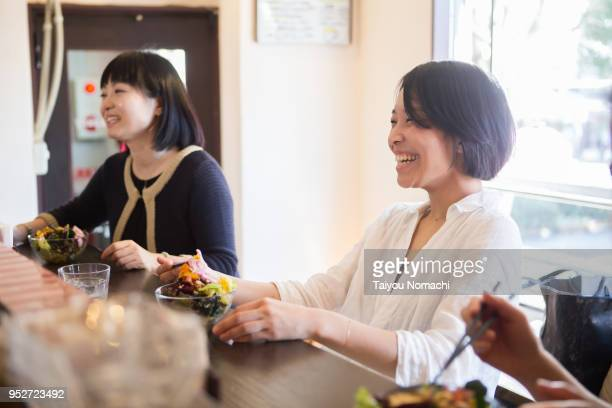 Women who enjoy eating at a restaurant where soft light enters
