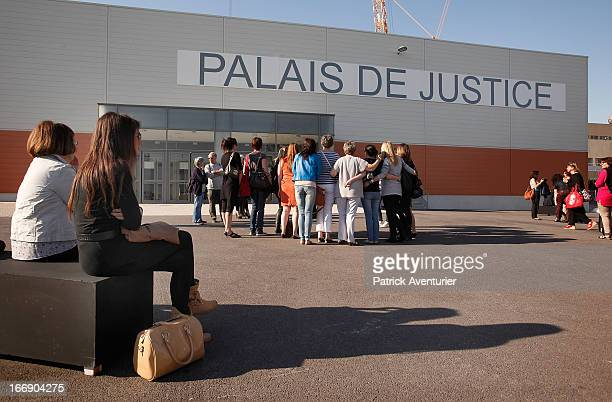 Women who received PIP breast implants arrive at the courthouse at Parc Chanot on April 18 2013 in Marseille France JeanClaude Mass and his PIP...