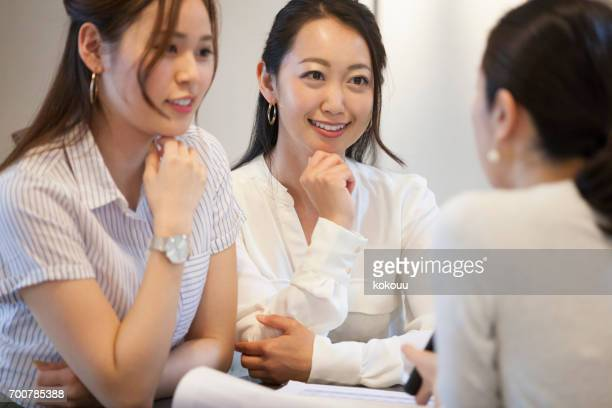 women who work in the office - human mouth stock pictures, royalty-free photos & images