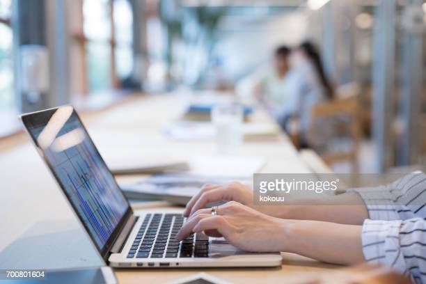 women who work in the office - input device stock photos and pictures