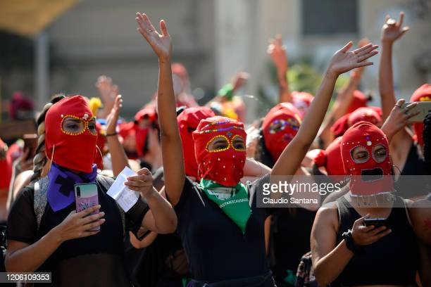 Women with a masks shout slogans during protests as part of the International Women's Day on March 8 2020 in Santiago Chile