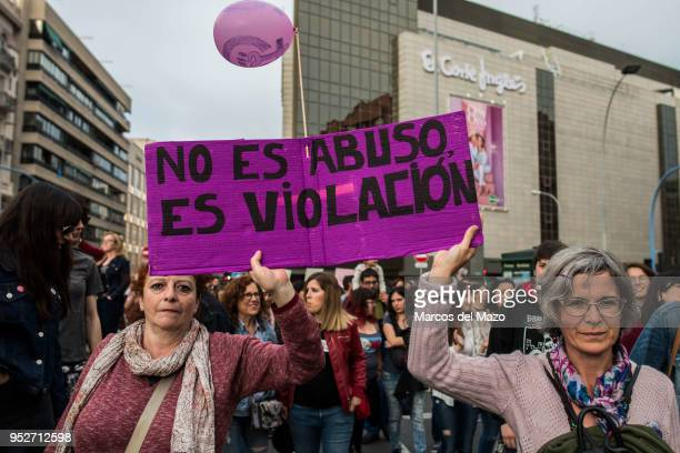 """Women with a placard that reads """"it is not abuse, it is rape"""" during a demonstration against the verdict of """"La Manada"""" case. The Court of Navarra..."""