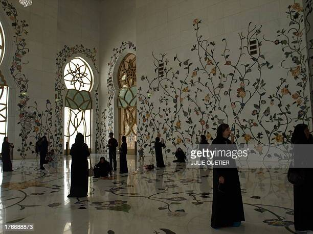 Women with abaya visiting the Sheikh Zayed Grand Mosque in Abu Dhabi, United Arab Emirates.