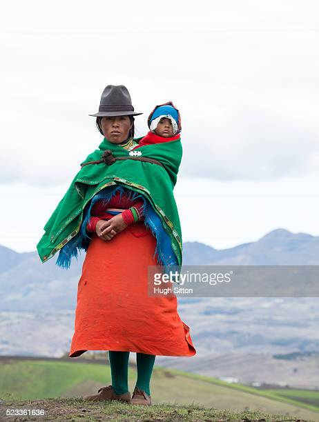 Women with baby (6-11 months) in highlands wearing traditional Ecuadorian costume, Ecuador