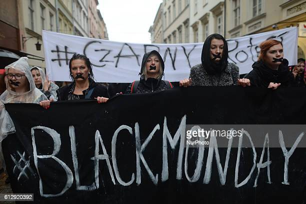 Women with banners wearing black participate in the Black Monday a nationwide women's proabortion protest on October 03 2016 at the Castle Square in...