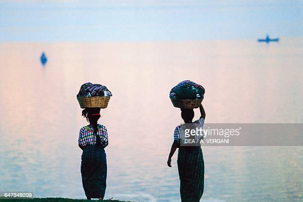 Women with baskets on their heads near Lake Atitlan Santiago Atitlan Guatemala