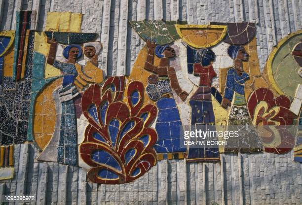 Women with children and baskets mosaic mural Lome Togo
