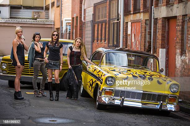 women with classic hot rods - david freund stock pictures, royalty-free photos & images