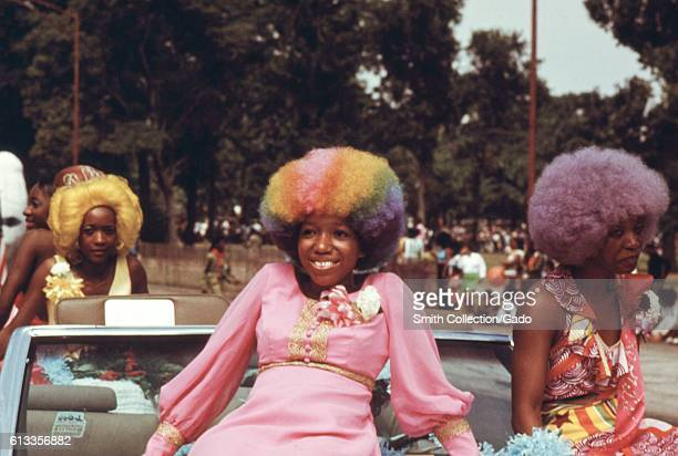 Women with colorful hair sit on a float during the Bud Billiken Day parade in Chicago Illinois August 1973 Image courtesy John White/US National...