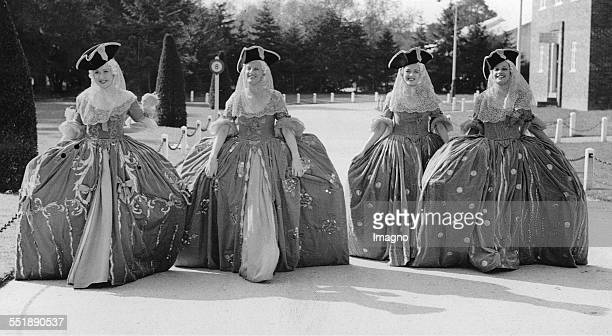 Women with crinoline appear in a Maurice Chevalier film Pinewood studios 2nd October 1937 Photograph