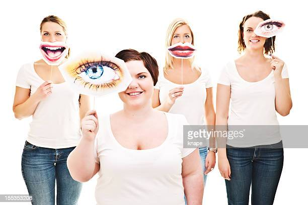 Women with eye and smile signs infront of them