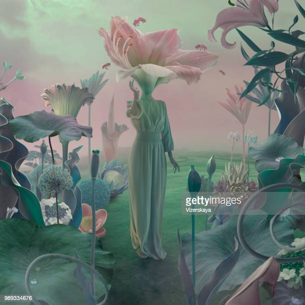 women with flower head in surreal garden - long dress stock pictures, royalty-free photos & images