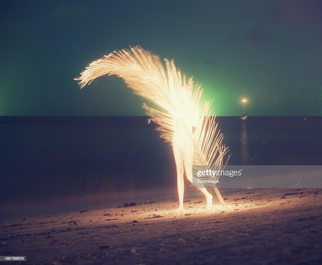 women with giant palm leaf at night beach. Kai Bae. Koh Chang. Thailand. 2014