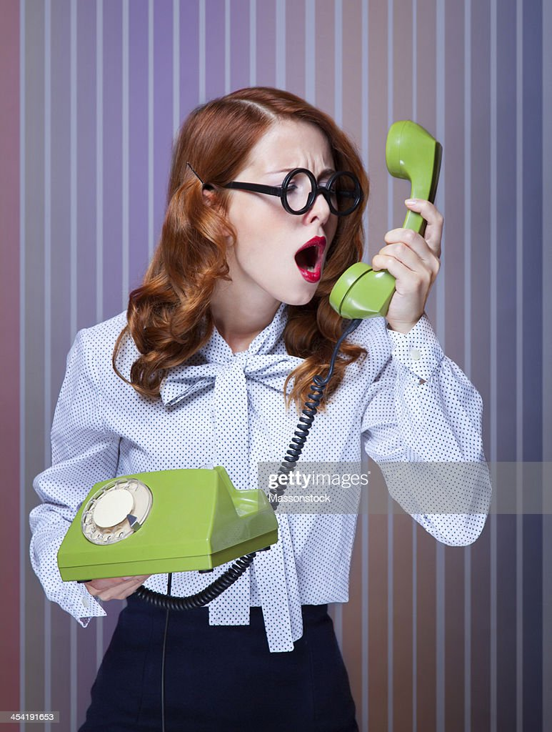 Women with green telephone : Stock Photo