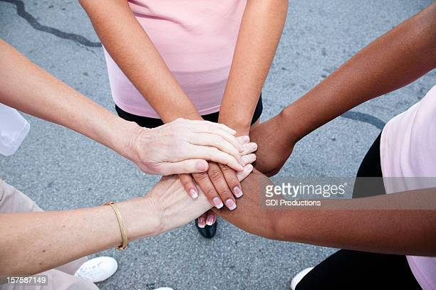 Women with Hands Together in a Circle