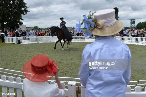 Women with hats watch a horse show during the Prix de Diane Longines 2018 on June 17 2018 in Chantilly France