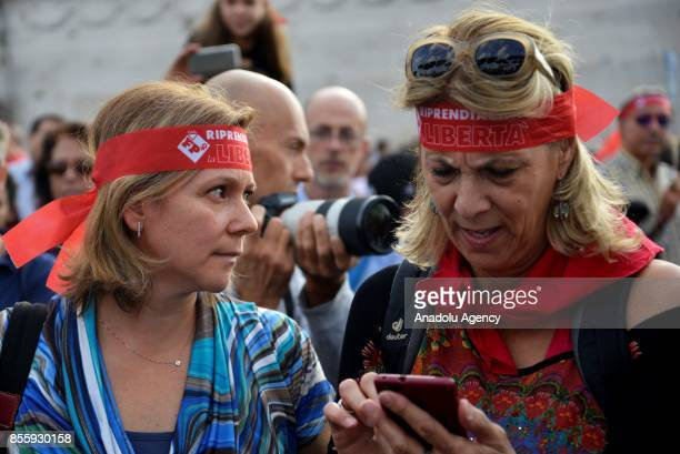 Women with head bands attend a protest against genderbased violence in Rome Italy on September 30 2017