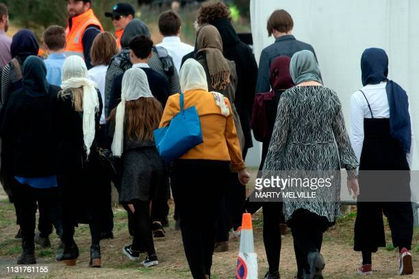 Women with head scarfs arrive at the funeral for two of those killed in the mosque attacks at Memorial Park Cemetery in Christchurch on March 21 2019...