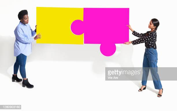 women with jigsaw pieces - casual clothing stock pictures, royalty-free photos & images