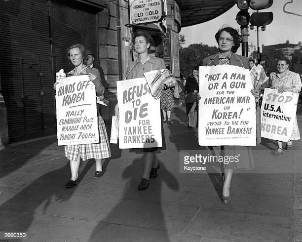 Women with placards demonstrating against the Korean War, as part of the Communist Peace Demonstration held at Marble Arch London.