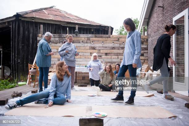 Women with protected clothes ready to start painting