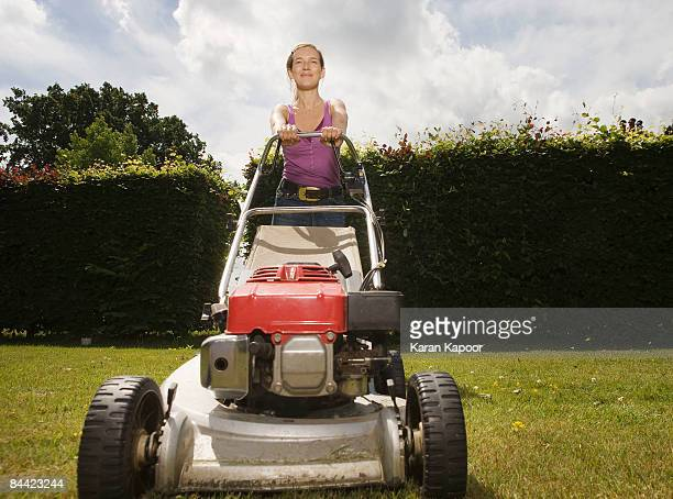 women with push lawnmower - lawn mower stock pictures, royalty-free photos & images