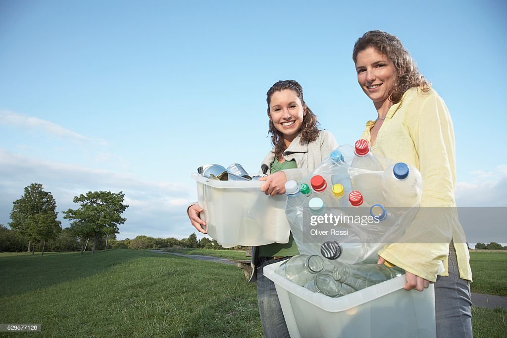 Women with Recycling Bins : Stock-Foto